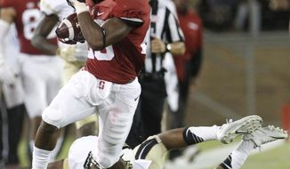 FILE - In this Sept. 12, 2015, file photo, Stanford's Bryce Love runs past Central Florida's Tre Neal during an NCAA college football game in Stanford, Calif. The Cardinal get an early start on the season, heading Down Under to take on Rice on Aug. 26 in Sydney.(AP Photo/Matthew Sumner, file)