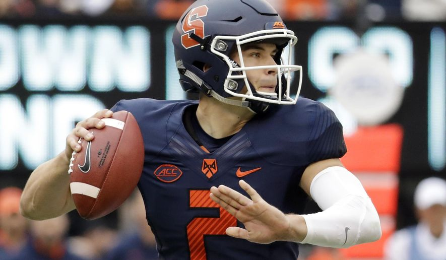FILE - In this Oct. 1, 2016, file photo, Syracuse quarterback Eric Dungey (2) throws a pass against Notre Dame during the first half of NCAA college football game, in East Rutherford, N.J.  Babers has a theory about his system _ year two, game four is when it should really begin to purr. Maybe sooner.  For fans of the Orange, and marketing managers at the school concerned about all those empty Carrier Dome seats at home games, sooner can't come soon enough. (AP Photo/Julio Cortez, File)