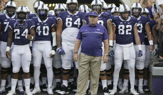 FILE - In this Sept. 3, 2016, filephoto, TCU head coach Gary Patterson waits to lead his team onto the field before an NCAA college football game against South Dakota State in Fort Worth, Texas. (AP Photo/LM Otero, File)