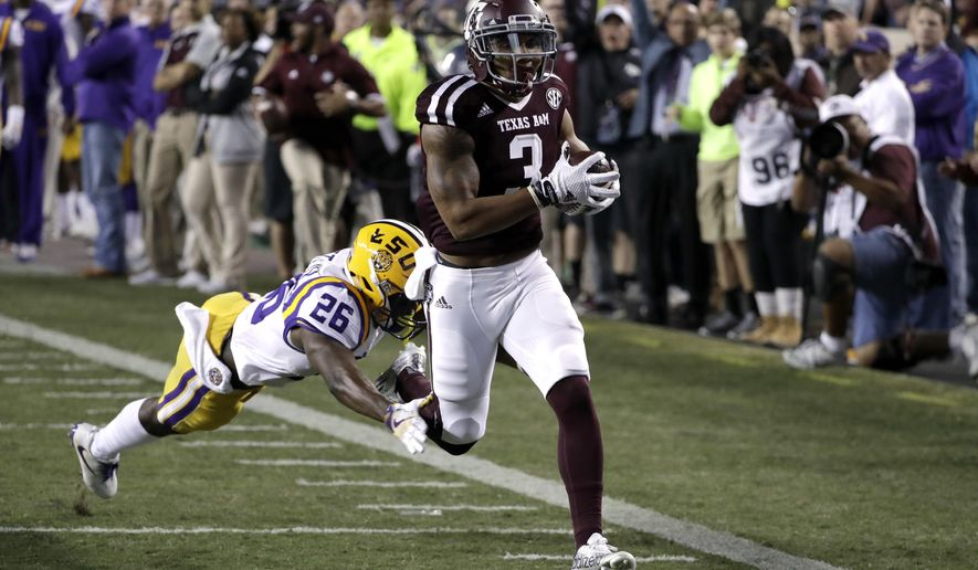 FILE - In this Nov. 24, 2016, file photo, Texas A&M wide receiver Christian Kirk (3) runs for end zone to score a touchdown after catching a pass as LSU safety John Battle (26) defends during the first quarter of a college football game, in College Station, Texas. Texas A&M's top returning starter is receiver/punt returner Christian Kirk. The junior had a Southeastern Conference-leading 83 receptions for 928 yards and nine touchdowns last season. He added three touchdowns on punt returns. (AP Photo/David J. Phillip, File)