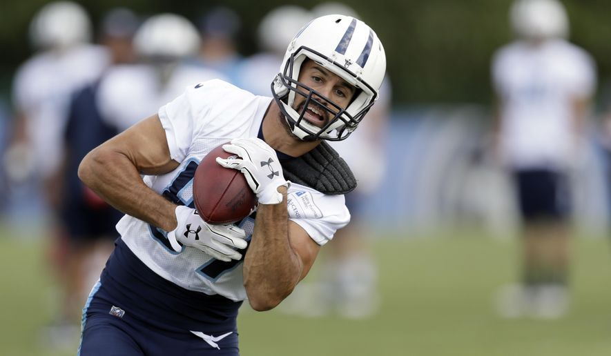 FILE - In this Aug. 8, 2017, file photo, Tennessee Titans wide receiver Eric Decker catches a pass during NFL football training camp in Nashville, Tenn. When the Titans play the New York Jets Saturday in a preseason game, Decker not only gets to play the team that let him go only weeks ago, he'll be starting for the Titans showing just how healthy he is. (AP Photo/Mark Humphrey, File)