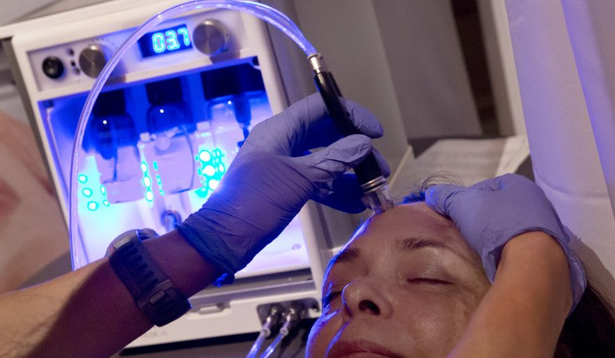 In this Aug. 8, 2017 photo, dermalinfusion, by Envy Medical of Long Beach, Calif., an advanced skin resurfacing treatment, is demonstrated at the annual International Spa Association event in New York. Wellness rather than beauty was the message this week as the spa industry gathered in New York for an annual event organized by the International Spa Association. While there were plenty of skin products and treatments on display, the bigger trend remains alleviating stress. (AP Photo/Richard Drew)