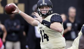 FILE - In this Oct. 1, 2016, file photo, Vanderbilt quarterback Kyle Shurmur throws a pass against Florida in the first half of an NCAA college football game in Nashville, Tenn. (AP Photo/Mark Humphrey, File)