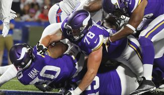 Minnesota Vikings running back C.J. Ham (30) rushes for a touchdown during the second half of a preseason NFL football game against the Buffalo Bills Thursday, Aug. 10, 2017, in Orchard Park, N.Y. (AP Photo/Jeffrey T. Barnes)