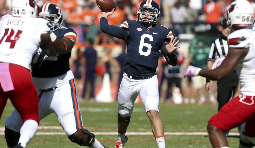 FILE - In this Oct. 29, 2016, file photo, Virginia quarterback Kurt Benkert (6) throws a pass during the team's NCAA college football game against Louisville in Charlottesville, Va. Benkert took nearly all the snaps in spring practice, and the only other player to take any, redshirt freshman De'Vante Cross, has also been working at wide receiver this fall. (AP Photo/Ryan M. Kelly, File)