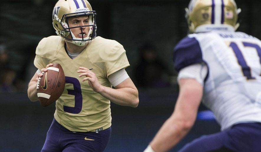 FILE - In this April 22, 2017, file photo, Washington quarterback Jake Browning (3) looks to pass during the NCAA college football team's spring game at Husky Stadium, in Seattle. It took Chris Petersen all of three years to put Washington back in the national conversation. Now, stay there. (Joshua Bessex/The News Tribune via AP, File)