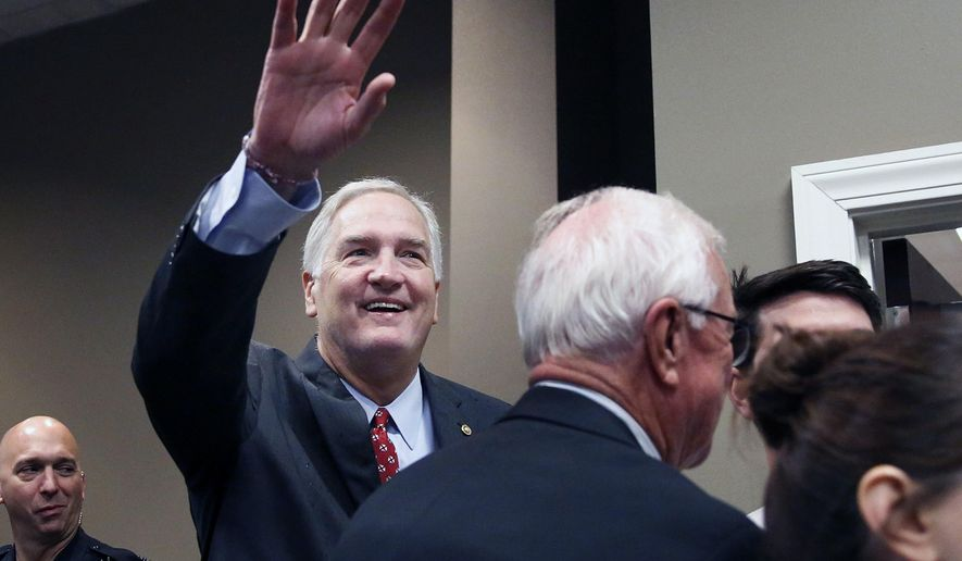 FILE - In this Aug. 4, 2017, file photo, Alabama Republican Sen. Luther Strange waves to constituents before a Republican Senate candidate forum in Pelham, Ala. President Donald Trump's feud with Senate Majority Leader Mitch McConnell hasn't yet become an all-out political proxy war. A super PAC aligned with Trump intends to help Strange's bid for re-election _ even though Strange is the candidate favored by McConnell. (AP Photo/Brynn Anderson, File)