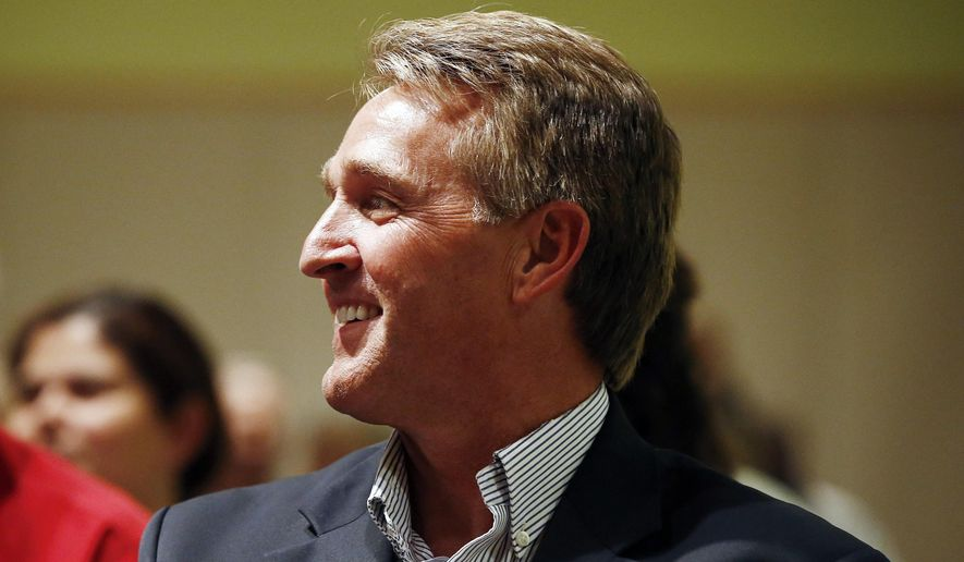 """In this May 30, 2017 file photo, Sen. Jeff Flake, R-Ariz., waits to be introduced prior to speaking in Glendale, Ariz. Rep. Krysten Sinema, D-Ariz. says she is """"seriously considering"""" a run for the Arizona Senate seat occupied by Republican Jeff Flake. (AP Photo/Ross D. Franklin, File)"""