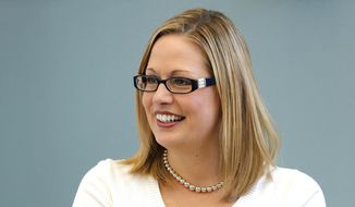 In this Aug. 20, 2013 file photo, Rep. Kyrsten Sinema, D-Ariz. is seen in Tempe, Ariz. (AP Photo/Matt York, File)