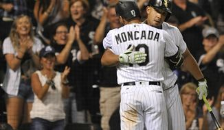 Chicago White Sox's Yoan Moncada (10) celebrates with teammate Jose Abreu, back, after hitting a solo home run during the ninth inning of a baseball game against the Houston Astros on Thursday, Aug. 10, 2017, in Chicago. (AP Photo/Paul Beaty)