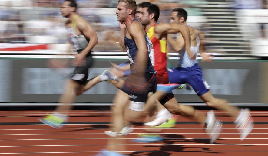 France's Kevin Mayer, front, competes in the 100m event of the decathlon during the World Athletics Championships in London Friday, Aug. 11, 2017. (AP Photo/Matthias Schrader)