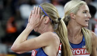 United States' gold medal winner Emma Coburn celebrates with United States' silver medal winner Courtney Frerichs, left, after the women's 3000m steeplechase final during the World Athletics Championships in London Friday, Aug. 11, 2017. (AP Photo/Matthias Schrader)