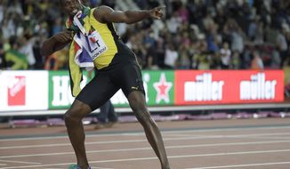 Jamaica's Usain Bolt performs his trademark pose on the finish line after placing third in the men's 100m final during the World Athletics Championships in London Saturday, Aug. 5, 2017. (AP Photo/Matthias Schrader)