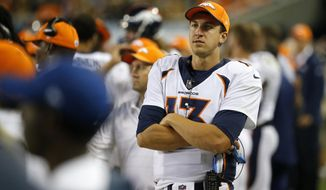 Denver Broncos quarterback Trevor Siemian (13) watches from the sideline during the second half of an NFL preseason football game against the Chicago Bears, Thursday, Aug. 10, 2017, in Chicago. (AP Photo/Charles Rex Arbogast)