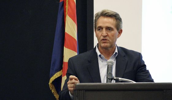 Sen. Jeff Flake addresses business officials gathered for an event in Prescott, Ariz., Thursday, Aug. 10, 2017. (AP Photo/Bob Christie) ** FILE **
