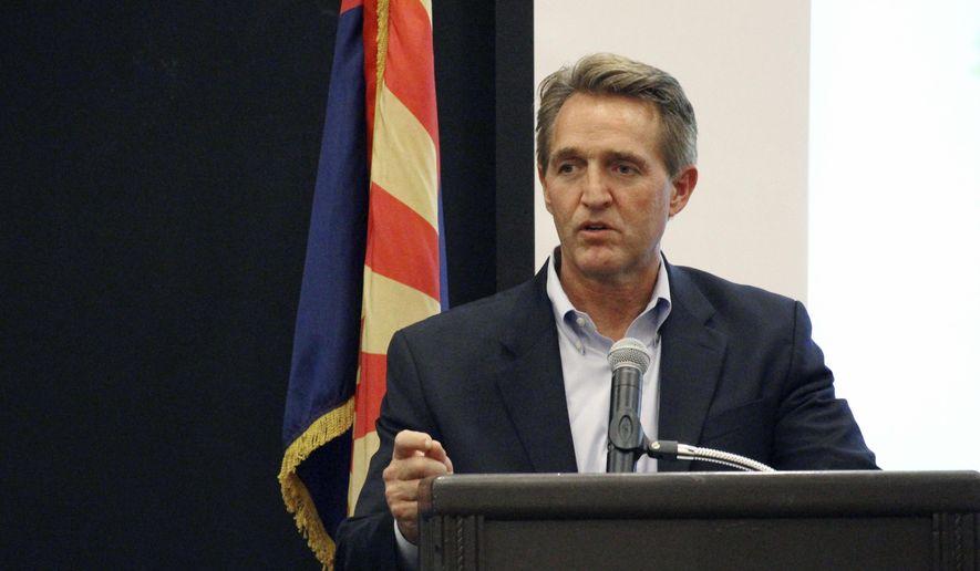 Sen. Jeff Flake addresses business officials gathered for an event in Prescott, Ariz., Thursday, Aug. 10, 2017. (AP Photo/Bob Christie) ** FILE **