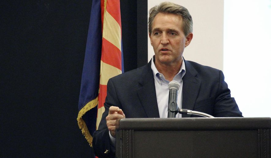 U.S. Sen. Jeff Flake addresses business officials gathered for an event in Prescott, Ariz., Thursday, Aug. 10, 2017. Flake told the group that that the new administration is restoring the balance on environmental regulations from what he called the one-sided oversight of the Obama Administration. (AP Photo/Bob Christie)