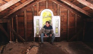 In this Oct. 20, 1997 photo, Chandler Saint ponders the daunting task of restoring the attic study of the Beecher House in Litchfield, Conn. Taken apart and stored in pieces, the house where Harriet Beecher Stowe grew up is for sale on eBay, with an asking price of $400,000. Museums passed on the building, and the owner went to the online auction site after finding no takers on Craigslist. (Patrick Raycraft/The Courant via AP)