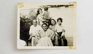 This late 1970's photo from the Naqvi & Zaidi family album shows Fahmida Hasan Zaidi, second right, with her mother Alamdari Begum, left, daughter Kahkashan Naqvi, front, younger sister Khurshid Zaidi, nephew Shiraz Zaidi, right, and young AP reporter Muneeza Naqvi in Lucknow, India. Zaidi lives in New Delhi while the rest of her seven siblings live in cities across Pakistan. For them, a generation raised on the idea that relationships could be nurtured for long periods on the simple sustenance of letters, physical distance has brought pain, but not an emotional distance. (AP Photo/Bernat Armangue)