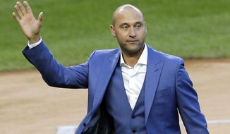 FILE - In this May 14, 2017, file photo, former New York Yankees player Derek Jeter waves to fans during a ceremony retiring his number at Yankee Stadium in New York. A person familiar with the negotiations says the Miami Marlins have told Major League Baseball they intend to sign an agreement to sell the team to a group that includes Jeter. The person confirmed the Marlins' plans to The Associated Press on condition of anonymity Friday, Aug. 11, 2017, because the team had not commented publicly. (AP Photo/Seth Wenig, File)