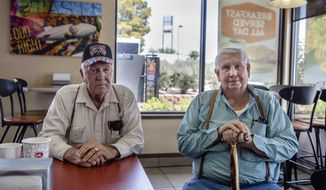 In this Tuesday, July 11, 2017 photo, Jimmie Hughes, right, the first mayor of Mesquite, sits in the local Jack in the Box with his friend, Tuffy Ruth, in Mesquite, Nev.. Hughes, Ruth and several other elderly men gather for lunch almost daily. Between 2011 and 2016, the town that housed 800 at its 1983 incorporation grew nearly 15 percent, from about 15,200 to 17,900, according to recent U.S. Census Bureau numbers. (Patrick Connolly/Las Vegas Review-Journal via AP)