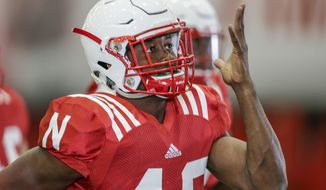 In this Aug. 3, 2017 photo, Nebraska defensive back Joshua Kalu warms up exercises at the start of NCAA college football preseason practice in Lincoln, Neb. Kalu, who started at cornerback the last two seasons, moved to safety in the spring and already has received eyebrow-raising praise from defensive coordinator Bob Diaco. (AP Photo/Nati Harnik)