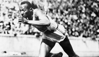In this Aug. 14, 1936, file photo, Jesse Owens competes in one of the heats of the 200-meter run at the 1936 Olympic Games in Berlin. Owens is the American track star who defied Adolf Hitler, winning the 100 meters, 200, 4x100 relay and long jump at the racially charged Berlins Olympics in 1936. (AP Photo/File) **FILE**