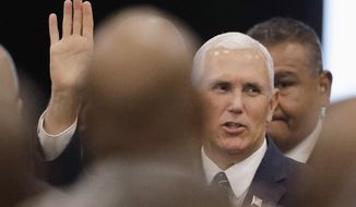 Vice President Mike Pence waves as he arrives for the Indianapolis Ten Point Coalition luncheon, Friday, Aug. 11, 2017, in Indianapolis. Pence is the keynote speaker at the luncheon. (AP Photo/Darron Cummings)