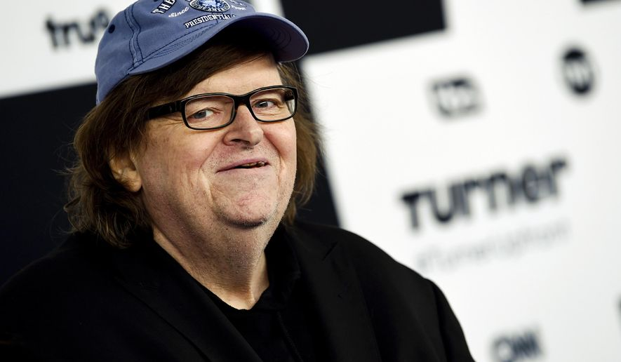 In this May 17, 2017 file photo, filmmaker Michael Moore attends the Turner Network 2017 Upfront presentation at The Theater at Madison Square Garden in New York. (Photo by Evan Agostini/Invision/AP, File)