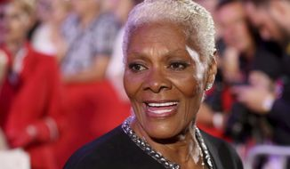 "FILE - In this June 10, 2017 file photo, singer Dionne Warwick arrives for the opening ceremony of the Life Ball in front of the City Hall in Vienna, Austria. Warwick will be honored with an award named for a pioneering opera singer.The Marian Anderson Award is given in Philadelphia to ""critically acclaimed artists who have impacted society in a positive way."" Anderson was the first black singer to perform at the Metropolitan Opera.Mayor Jim Kenney announced Thursday, Aug. 10,  that the five-time Grammy winner will receive the award at a Nov. 14 ceremony.(AP Photo/Ronald Zak, File)"