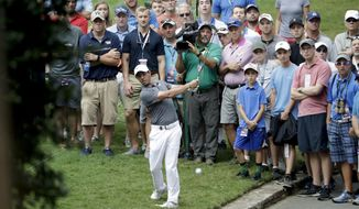 Rory McIlroy of Northern Ireland, hits from the rough on the 10th hole during the second round of the PGA Championship golf tournament at the Quail Hollow Club Friday, Aug. 11, 2017, in Charlotte, N.C. (AP Photo/John Bazemore)