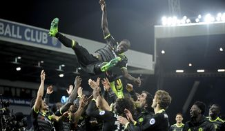 FILE - In this May 12, 2017, file photo, Chelsea's players throw Chelsea's N'Golo Kante in the air to celebrate after the English Premier League soccer match against West Bromwich Albion, at the Hawthorns in West Bromwich, England. Trying to gauge what it can sell directly to cord cutters, NBC is launching its direct-to-consumer Premier League product with the start of the season this weekend. The company still will air about 250 matches on its television networks, mostly NBCSN, NBC and CNBC. But 130 games are being moved to its stream. (AP Photo/Rui Vieira, File)
