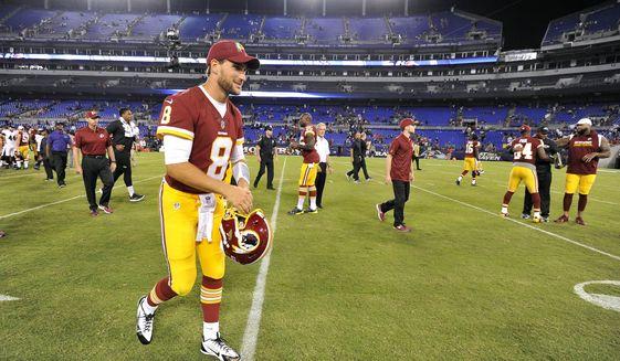 Washington Redskins quarterback Kirk Cousins walks off the field after a preseason NFL football game against the Baltimore Ravens, Thursday, Aug. 10, 2017, in Baltimore. Baltimore won 23-3. (AP Photo/Gail Burton)