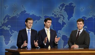 "This Aug. 10, 2017, photo provided by NBC shows Alex Moffat as Eric Trump, left, Mikey Day as Donald Trump Jr., center, and Colin Jost on set during the debut episode of ""Weekend Update: Summer Edition,"" in New York. The ""Saturday Night Live"" spinoff runs through the end of the month. (Rosalind O'Connor/NBC via AP)"