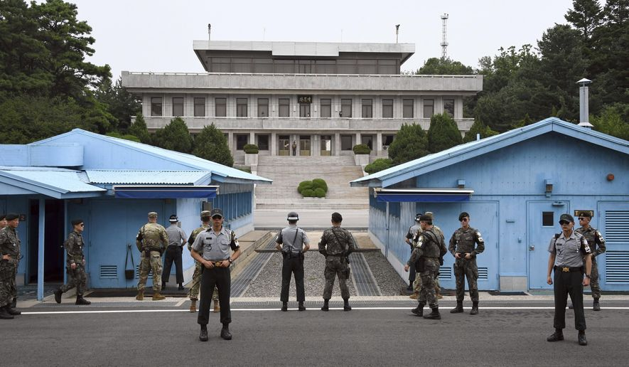 FILE - In this July 27, 2017 file-pool photo, South Korea and U.S. soldiers stand guard during a commemorative ceremony for the 64th anniversary of the signing of the Korean War Armistice Agreement at the truce village of Panmunjom in the Demilitarized Zone (DMZ) dividing the two Koreas. Beyond the bluster, the Trump administration has been quietly engaged in back channel diplomacy with North Korea for several months, addressing Americans imprisoned in the communist country and deteriorating relations between the long-time foes, The Associated Press has learned.  (Jung Yeon-Je/Pool Photo via AP, File)