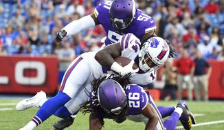 Minnesota Vikings' Trae Waynes (26) and Edmond Robinson (51) tackle Buffalo Bills' Sammy Watkins (14) on a punt return during the first half of a preseason NFL football game Thursday, Aug. 10, 2017, in Orchard Park, N.Y. (AP Photo/Rich Barnes)
