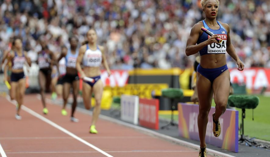 United States' Natasha Hastings anchors her team to win a Women's 4x400m relay heat during the World Athletics Championships in London Saturday, Aug. 12, 2017. (AP Photo/David J. Phillip)