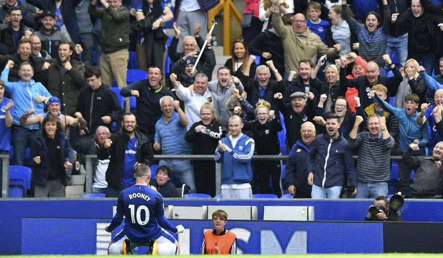 Everton's Wayne Rooney celebrates scoring his side's first goal against Stoke City during the English Premier League soccer match at Goodison Park, Liverpool, England, Saturday, Aug. 12, 2017. (Anthony Devlin/PA via AP)