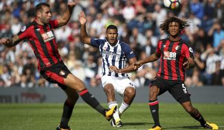 West Bromwich Albion's Salomon Rondon, centre, and AFC Bournemouth's Nathan Ake, right, challenge for the ball during the English Premier League soccer match at The Hawthorns, West Bromwich, England, Saturday Aug. 12, 2017. (Nick Potts/PA via AP)