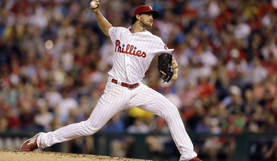 Philadelphia Phillies' Aaron Nola pitches during the third inning of a baseball game against the New York Mets, Saturday, Aug. 12, 2017, in Philadelphia. (AP Photo/Matt Slocum)