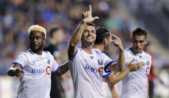Montreal Impact's Blerim Dzemaili gestures to the crowd after scoring a goal during the second half of the team's MLS soccer match against the Philadelphia Union on Saturday, Aug. 12, 2017, in Chester, Pa. The Impact won Union 3-0. (AP Photo/Michael Perez)