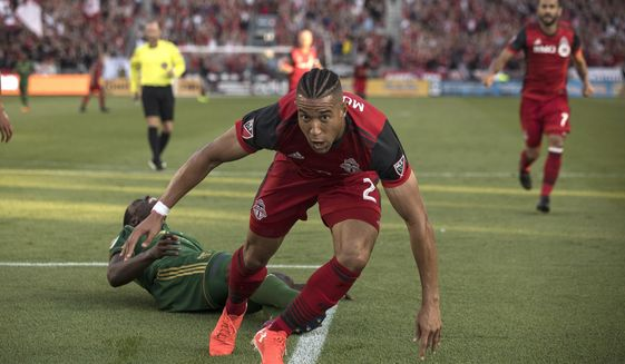 Toronto FC's Justin Morrow celebrates after scoring against the Portland Timbers during the second half of an MLS soccer match Saturday, Aug. 12, 2017, in Toronto. (Chris Young/The Canadian Press via AP)