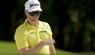 Chris Stroud watches his shot on the eighth hole during the third round of the PGA Championship golf tournament at the Quail Hollow Club Saturday, Aug. 12, 2017, in Charlotte, N.C. (AP Photo/Chuck Burton)
