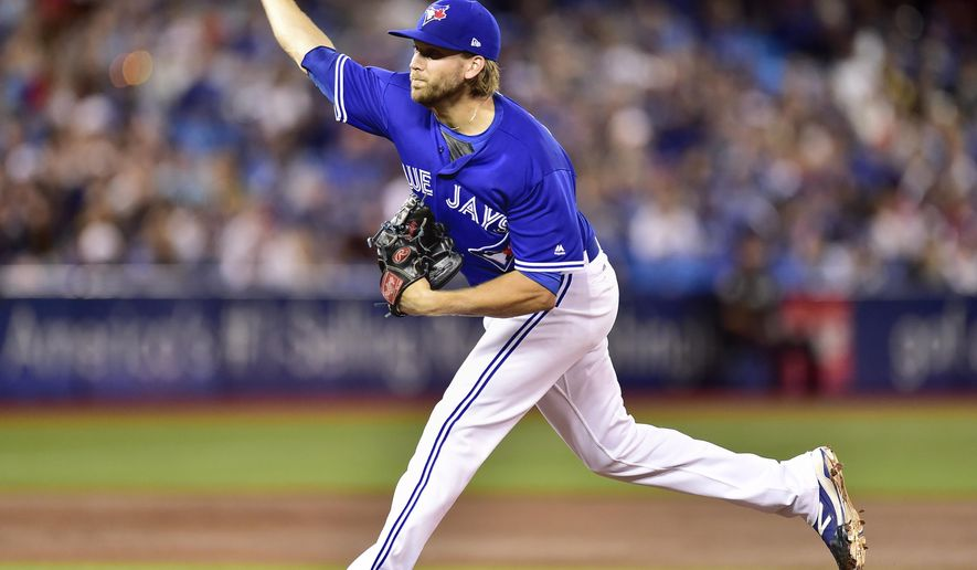 Toronto Blue Jays starting pitcher Chris Rowley works during second inning baseball action against the Pittsburgh Pirates in Toronto on Saturday, Aug. 12, 2017. (Frank Gunn/The Canadian Press via AP)