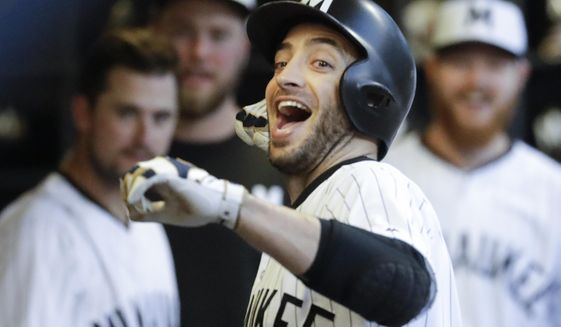 Milwaukee Brewers' Ryan Braun celebrates his home run during the fifth inning of a baseball game against the Cincinnati Reds Saturday, Aug. 12, 2017, in Milwaukee. (AP Photo/Morry Gash)