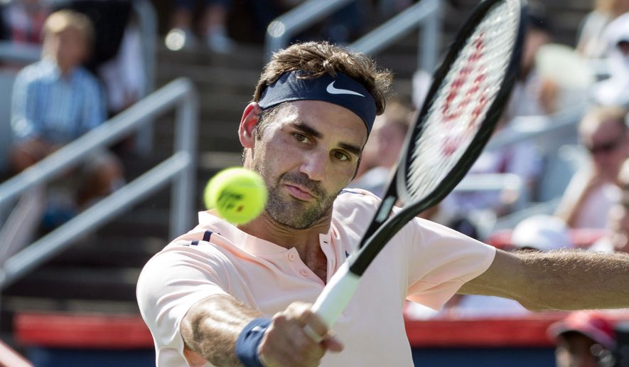 Roger Federer, of Switzerland, returns the ball to Robin Haase, of the Netherlands, during Rogers Cup tennis action in Montreal on Saturday, Aug. 12, 2017. (Paul Chiasson/The Canadian Press via AP)