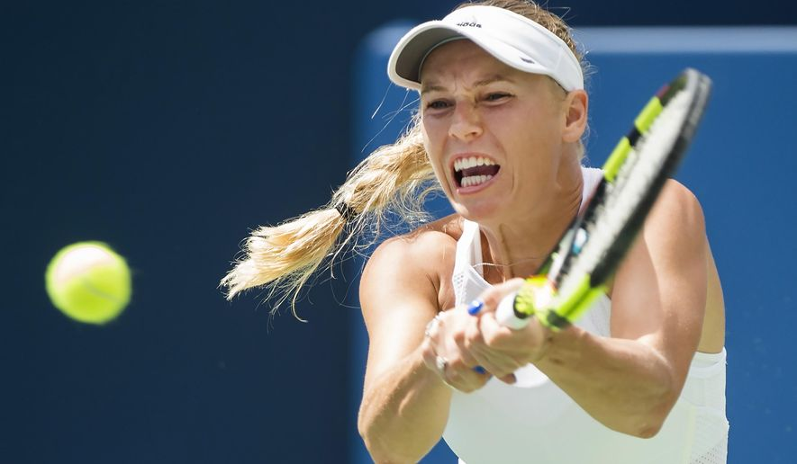 Caroline Wozniacki, of Denmark, returns the ball against Sloane Stephens, of the United States, during women's semi-final Rogers Cup tennis action in Toronto on Saturday, Aug. 12, 2017. Wozniacki won the match, advancing to the finals. (Nathan Denette/The Canadian Press via AP)