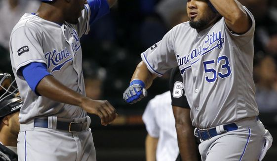 Kansas City Royals' Melky Cabrera, right, celebrates with Lorenzo Cain after hitting a two-run home run during the eighth inning of a baseball game against the Chicago White Sox, Saturday, Aug. 12, 2017, in Chicago. (AP Photo/Nam Y. Huh)