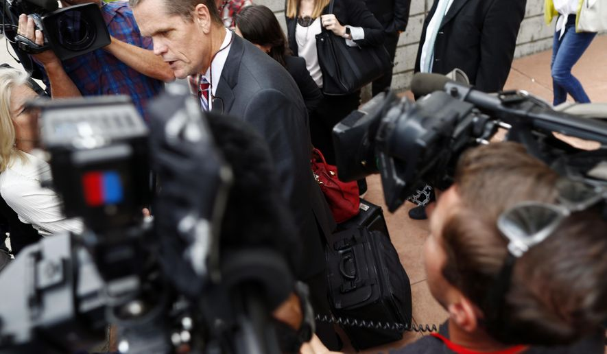 Attorney Douglas Baldridge, center, who represented pop singer Taylor Swift, emerges from the federal courthouse after a ruling in the civil trial for the singer to determine whether a Denver radio announcer groped the singer in a case in federal court late Friday, Aug. 11, 2017, in Denver. A judge on Friday threw out a former radio host's case against Taylor Swift in a trial that delved into their dueling lawsuits over whether he groped her during a backstage meet-and-greet and whether she and her team ruined his career.  (AP Photo/David Zalubowski)
