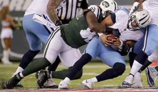 New York Jets nose tackle Leonard Williams (92) sacks Tennessee Titans quarterback Marcus Mariota (8) during the first quarter of an NFL football game, Saturday, Aug. 12, 2017, in East Rutherford, N.J. (AP Photo/Julio Cortez)